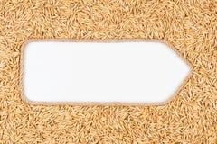 Pekare som göras från rep med kornhavre som ligger på en vit bakgrund Arkivfoto