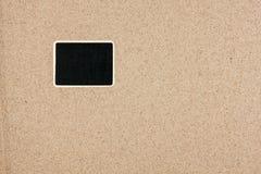 Pekaren annonser stiger ombord i formrektangeln i sanden Fotografering för Bildbyråer