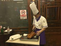 Pekin duck. Chinese chef cutting the traditional Peking duck, a tasty traditional food of Stock Photography