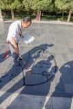 Peking Älterer chinesischer Schreibkünstler Stockfotografie