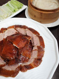 Peking Duck. Slices of roasted peking duck, served with pastry, cucumber and spring onion Stock Image