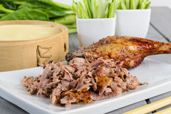 Peking Duck. Chinese roast duck served with pancakes, cucumber and spring onions Stock Photos