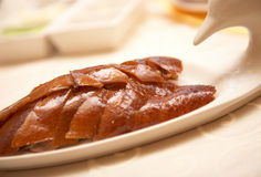 Peking duck. Peking roasted duck on plate for serving Stock Photography