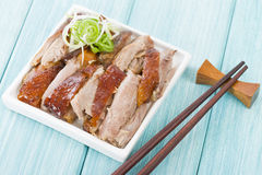Peking Duck. Chinese roast crispy duck on a blue background Stock Photography