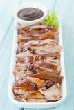 Peking Duck. Chinese roast crispy duck on a blue background Royalty Free Stock Images