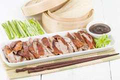 Peking Duck. Chinese roast crispy duck served with hoisin sauce, pancakes, cucumber and spring onions Royalty Free Stock Photo