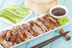 Peking Duck. Chinese roast crispy duck served with hoisin sauce, pancakes, cucumber and spring onions Royalty Free Stock Photography