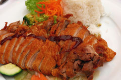 Peking duck Chop Suey with steamed rice close up Stock Images