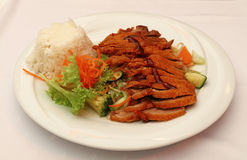 Peking duck Chop Suey with steamed rice close up Royalty Free Stock Photos