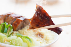 Peking Duck close up. Peking Duck - Chinese roast crispy duck, close up with chopsticks. Fresh cooked with hot steam and smoke Royalty Free Stock Photo
