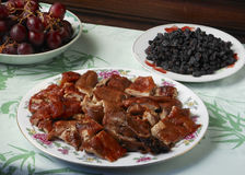 Peking duck. Feast with grapes Royalty Free Stock Photography