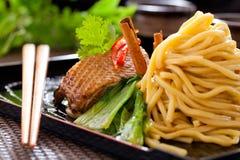 Peking duck noodle. Asian roasted duck noodle soup stock image