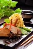 Peking duck noodle. Asian roasted duck noodle soup stock photo