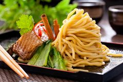 Peking duck noodle. Asian roasted duck noodle soup royalty free stock image