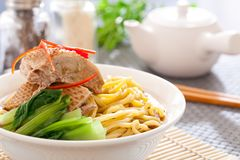 Peking duck noodle. Asian roasted duck noodle soup royalty free stock photo