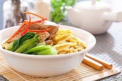 Peking duck noodle. Asian roasted duck noodle soup stock images
