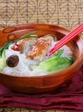 Peking Duck Noodle Soup. Popular Asian Cuisine; Slices of Roasted Peking Duck with Rice Noodles Soup Bowl Stock Photo