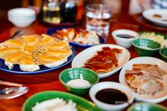Peking Duck. Chinese roast duck served with pancakes, cucumber, spring onions and plum sauce Stock Photography