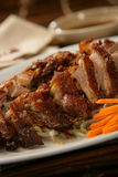 Peking duck on plate Stock Photo