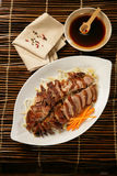 Peking duck on plate. Peking duck with vegetable on plate Royalty Free Stock Images