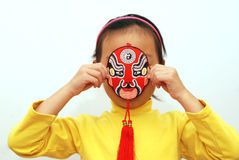 Peking Opera mask and little girl Royalty Free Stock Image