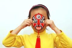 Peking Opera mask and little girl royalty free stock image
