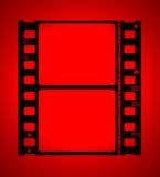 película de filme de 35mm na luz vermelha Foto de Stock Royalty Free