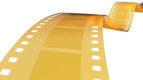película del oro de 35 milímetros en el blanco 1 Imagen de archivo libre de regalías