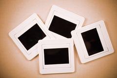 Película plástica vieja de la diapositiva en el papel Fotos de archivo libres de regalías