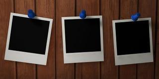Películas de la foto fijadas en el tablero de madera Fotografía de archivo libre de regalías