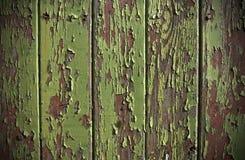Peladura verde de la pintura de una puerta del panel de madera Fotografía de archivo libre de regalías