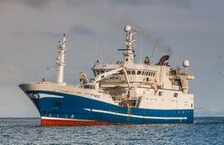 Pelagic fishing Vessel. Icelandic pelagic fishing vessel Beitir NK-123 approaching port in Helguvik, Iceland, with Capelin royalty free stock images