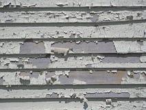 Pelatura della pittura bianca sulle assicelle Fotografie Stock