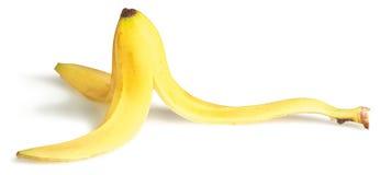 Pele de banana escorregadiço em um fundo branco Imagens de Stock Royalty Free