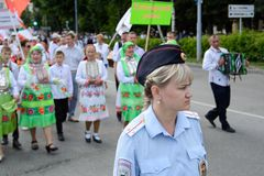Peledysh payrem. Yoshkar-Ola, Russia - June 25, 2016 A police woman follows the order at the national festival of the people of Mari Peledis Pairm Royalty Free Stock Images