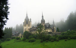 Peles Castle – Romania. View of Peles Castle in one misty morning. Full color picture Royalty Free Stock Photos