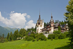 Peles castle. Scenic view of Peles castle with Carpathian mountains in background, Sinaia, Prahova County, Romania Royalty Free Stock Image