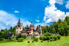 Peles castle. Beautiful Peles castle and ornamental garden in Sinaia landmark of Carpathian mountains in Europe Royalty Free Stock Photo