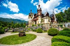 Peles castle. Beautiful Peles castle and ornamental garden in Sinaia landmark of Carpathian mountains in Europe Royalty Free Stock Image