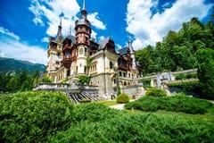 Peles castle. Beautiful Peles castle and ornamental garden in Sinaia landmark of Carpathian mountains in Europe Royalty Free Stock Images
