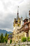 Peles Castle with the big tower. In the middle in beautiful Romania on a cloudy autumn day Royalty Free Stock Photography