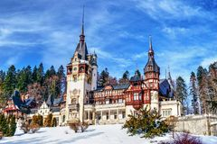 Peles Castle Romania in a clear winter day. Peles Castle, Neo-Renaissance castle in the Carpathian Mountains in Sinaia, Romania, residence of Romanian king royalty free stock photo