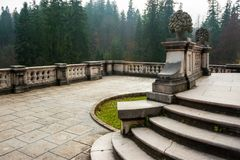 Peles castle ornamental garden balcony, Sinaia, Romania. Landmark of Carpathian mountains in Europe. View from the left.  stock image