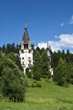 Peles Castle, Romania. A view from left-front side of Peles Castle located in Sinaia, Romania Royalty Free Stock Image