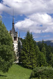 Peles Castle, Romania. A view from left-front side of Peles Castle located in Sinaia, Romania Royalty Free Stock Photos