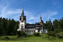 Peles Castle, Romania. A view from left-front side of Peles Castle located in Sinaia, Romania Royalty Free Stock Images