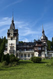 Peles Castle, Romania. A view from left-front side of Peles Castle located in Sinaia, Romania Royalty Free Stock Photo