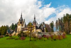 Peles castle, Sinaia, Romania. Blue sky and white clouds.  Royalty Free Stock Images