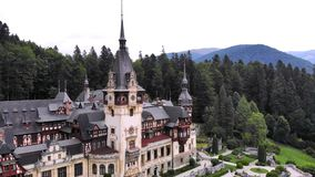 Peles castle. Sinaia, Romania. The castle is surrounded by beautiful carpathian mountains.