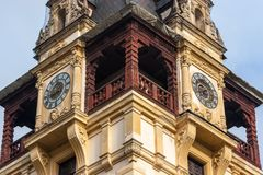Peles castle, Sinaia, Romania.Overcast on a beautiful autumn day. Clock tower detailed view stock photography